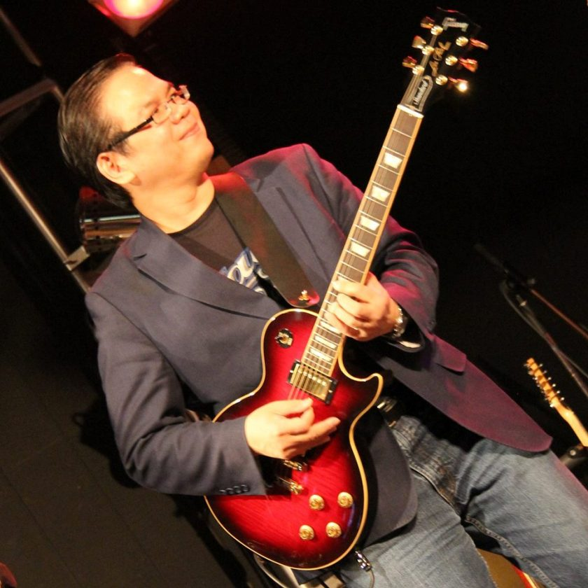 dune-nguyen-with-gibson-les-paul-guitar