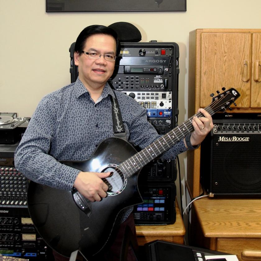 dune-nguyen-with-acoustic-guitar.jpg